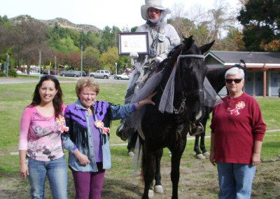 Gwen Allen presenting Best Costume Award, Corral 22 Christmas Ride, Griffith Park, Burbank, California, December, 2009 (rider and other people not known)