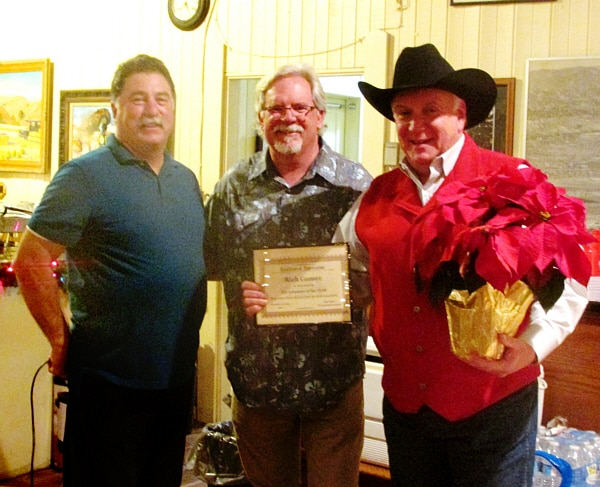 Bob Foster, ETI President, and Rick Balthaser, ETI Corral 357 President, presenting Rich Gomez, Corral 357, with his Volunteer of the Year at the holiday party.