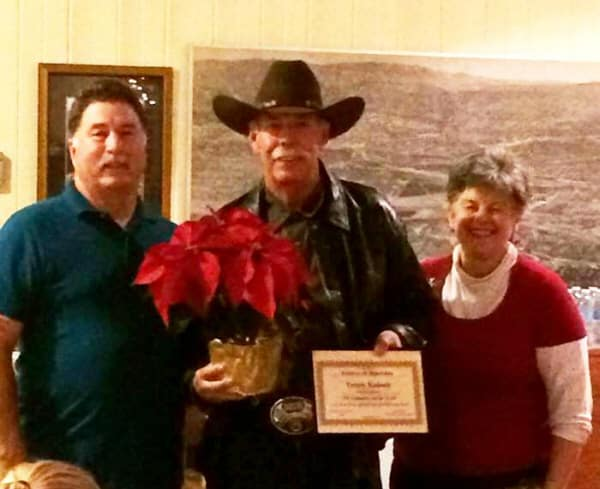 Bob Foster, ETI President, and Linda Fullerton presenting Terry Kaiser, ETI Corral 20, with his Volunteer of the Year award at the ETI holiday party.